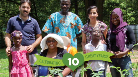 Green banner with photo of seven people posing together for a photo in a garden on the right side.